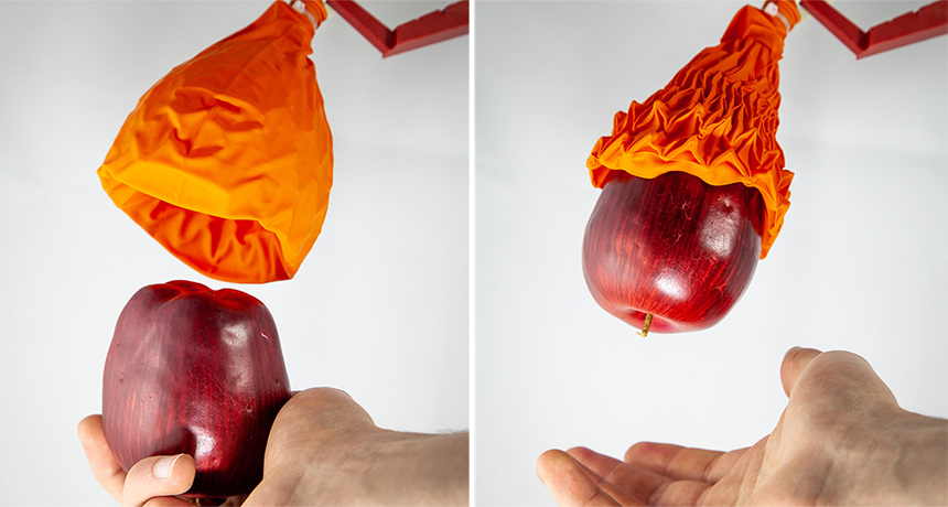 robotic gripper grabbing an apple