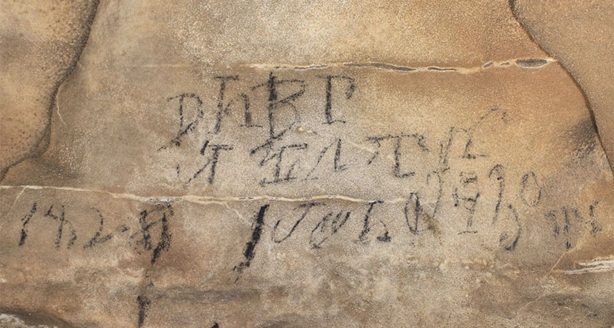 a photo of a Cherokee inscription on the wall of a cave