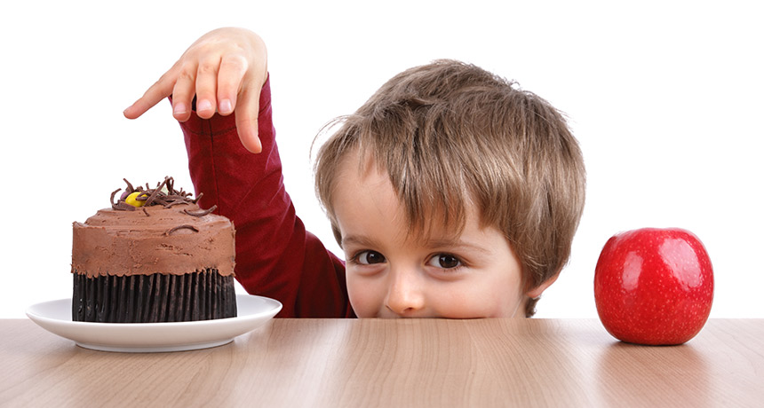 little kid choosing between cake or apple