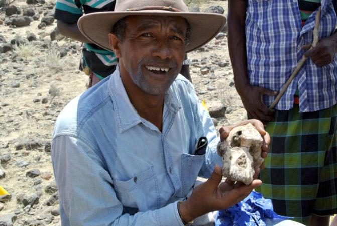 Yohannes Haile-Selassie holding skull