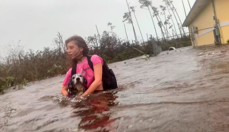 woman carrying dog in Bahamas