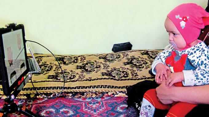 Tajik child watches cartoon
