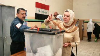 woman voting in Iraq