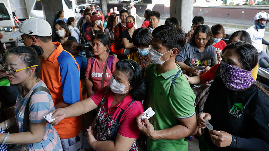 people buying face masks in Manila