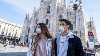 people wearing masks in Milan