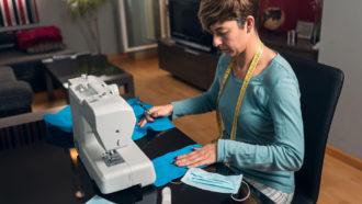 woman sewing masks