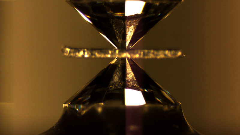 a superconductor being squeezed between two diamonds