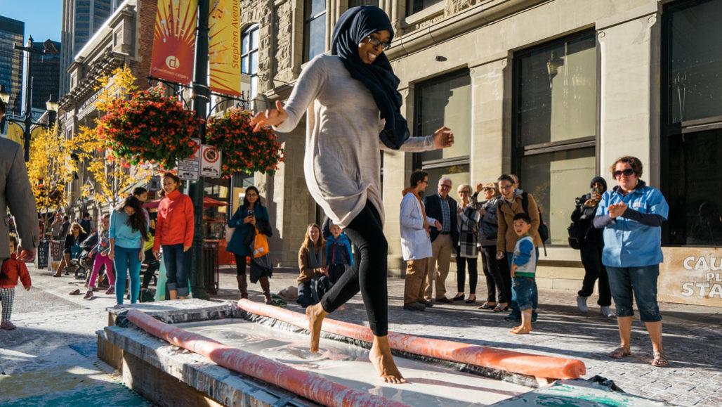 woman running barefoot across pit of ooblek