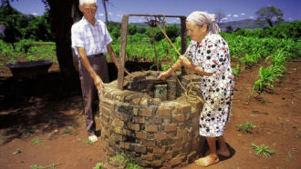 people at a well in Misiones, Argentina