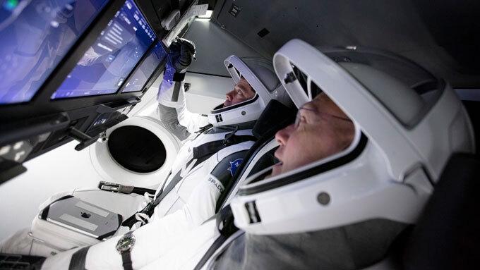NASA astronauts in a flight simulator