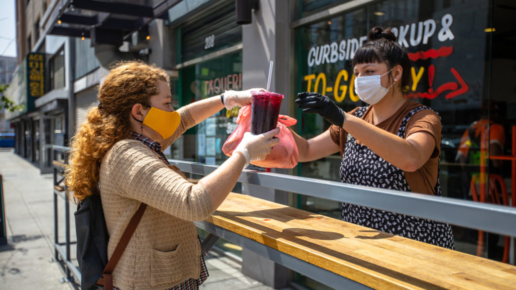 People wearing masks at a restaurant