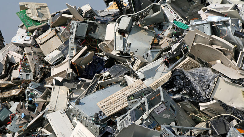 huge pile of discarded keyboards, computers and more