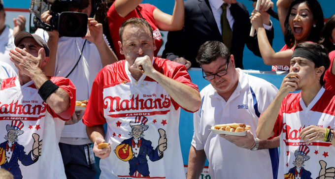 Joey Chestnut eating hot dogs at the 2019 Nathan's Famous Hot Dog Eating Contest