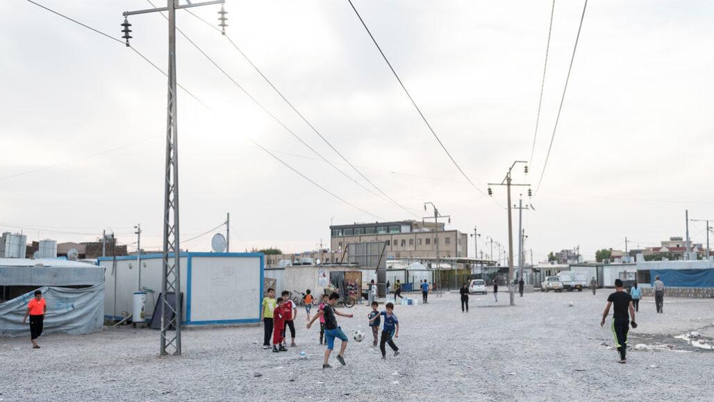 children playing soccer in Iraq