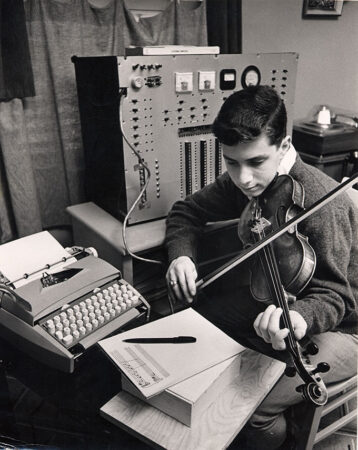 A young Ray Kurzweil plays a composition on the violin