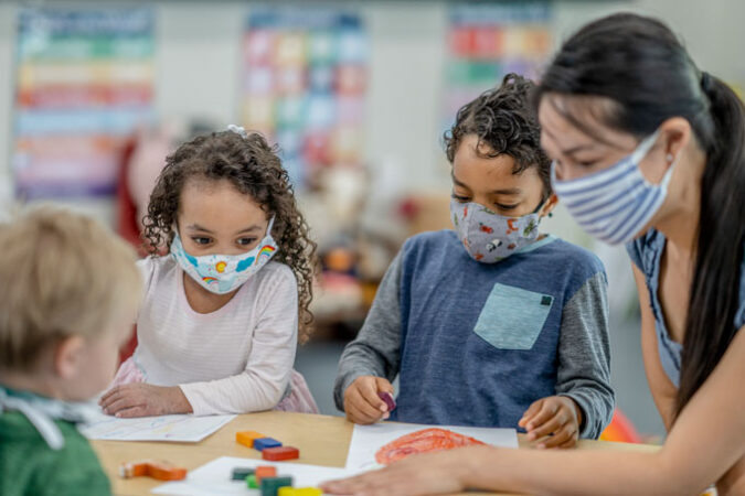 young children wearing masks in school due to COVID-19