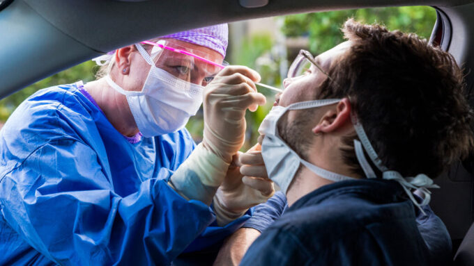 Person in a car getting a nasal swab test