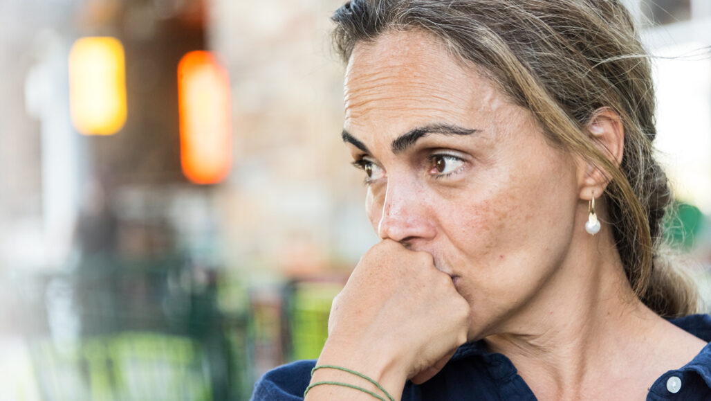 woman staring off to the side looking troubled