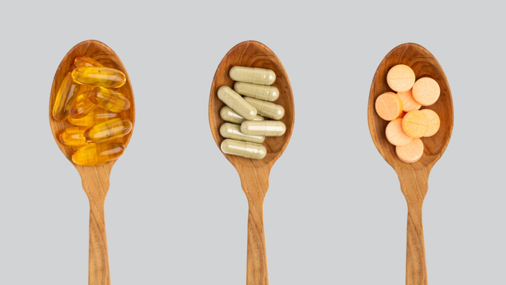 supplement pills in spoons