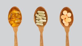 supplement pills in spoons