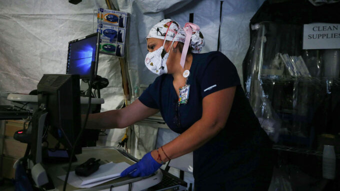 medical professional wearing a mask working in a tent