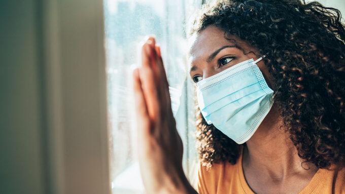 woman inside wearing mask