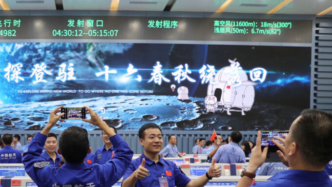 team members of China's Chang'e-5 mission celebrating the spacecraft's launch