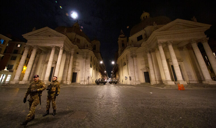 empty street in Rome with two soldiers and two tanks on patrol