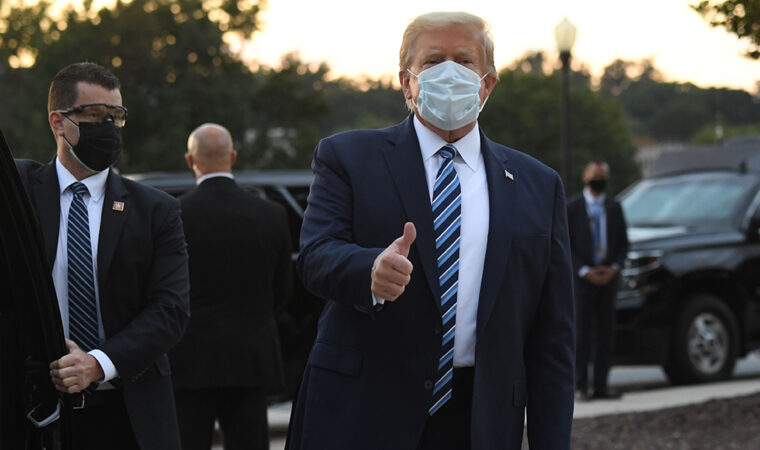 Donald Trump wearing a surgical mask giving a thumbs-up