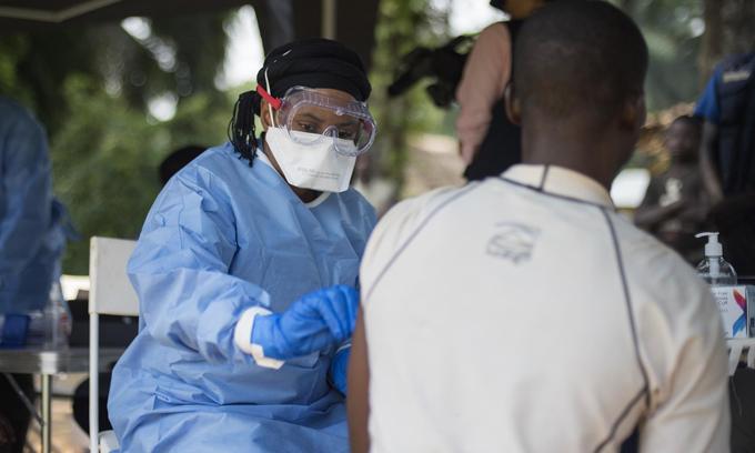 man receives an Ebola vaccine