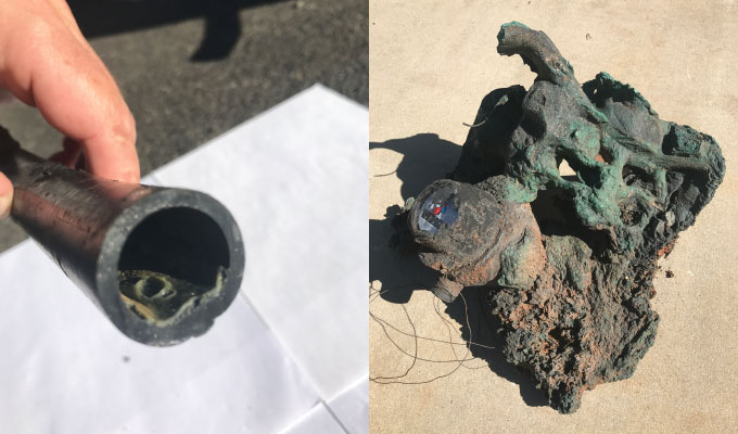 burned plastic pipe and meter box