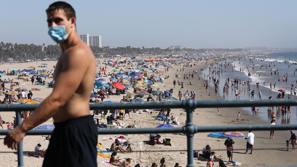 man wearing mask at Santa Monica beach