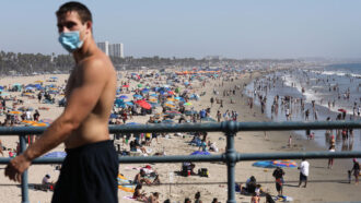 man wearing mask at Santa Monica beach