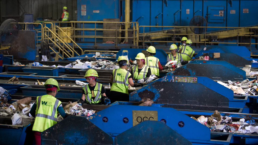 workers sorting at a waste management facility