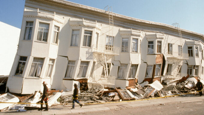 block of row houses off kilter from earthquake damage