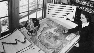 photo of Marie Tharp and her map