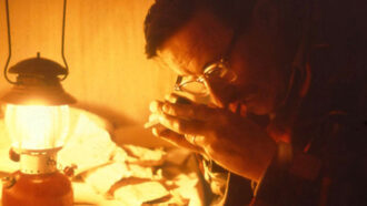 Harry Whittington looking at fossils
