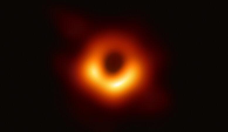 orange halo around black central sphere