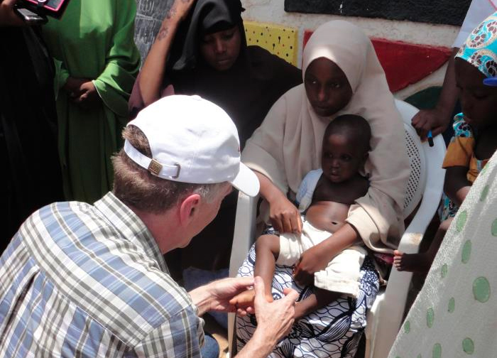 the doctor examines a child in Nigeria