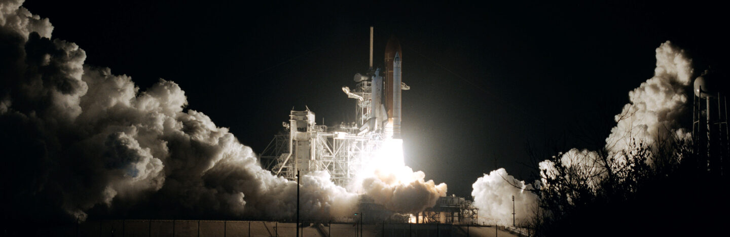 space shuttle Columbia launching at night