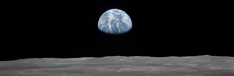 Earth rising over moon's horizon