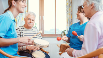 people playing instruments in a nursing home environment