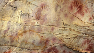 red ochre handprints in a cave