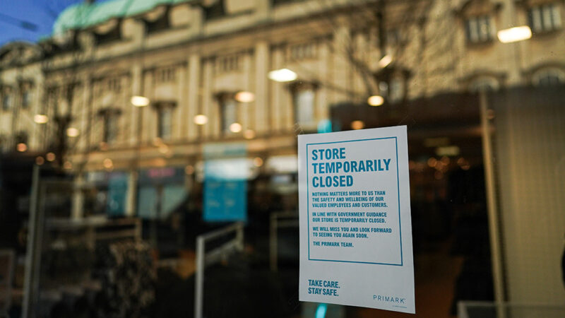 temporary closed sign in a store window