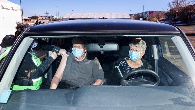 Jack Cook recieving his covid-19 vaccine shot in his car