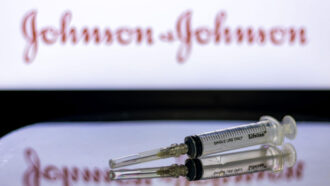 vaccine syringe with Johnson & Johnson logo