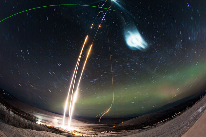 photo time lapse of three rocket launches and chemical tracers in the night sky