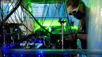 researcher working on laser-cooled plasma experiment