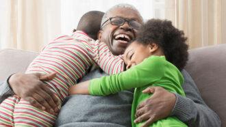 children hugging happy older person