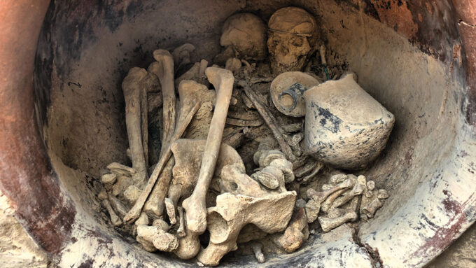 bones of a man and woman with artifacts in a bronze age grave